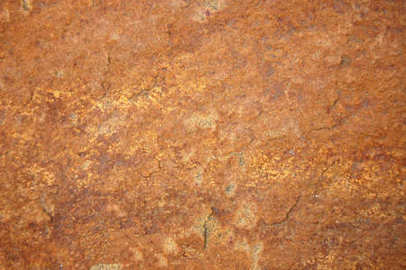 sandstone: texture of a sandstone rock with reddish surface