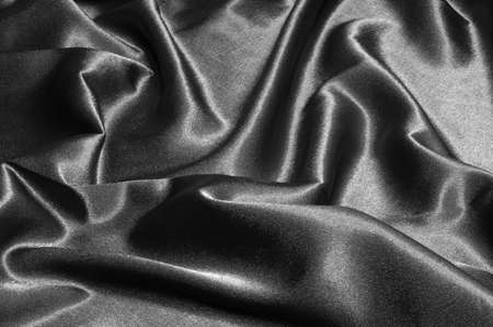 black satin or silk background with textile texture