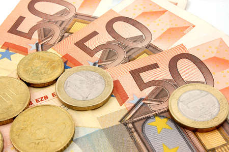 macro of euro bills and coins can be used as background photo