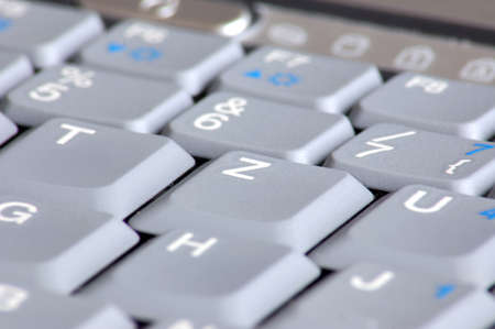 gray keyboard of a business laptop computer photo