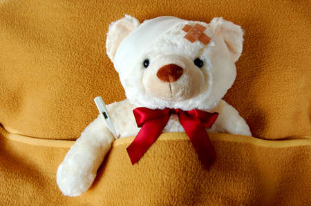 ill teddy bear in bed waiting for medicine photo