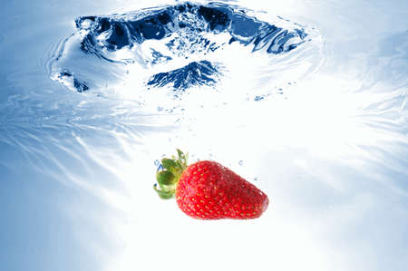 strawberry splash in warter showing healthy lifestyle photo