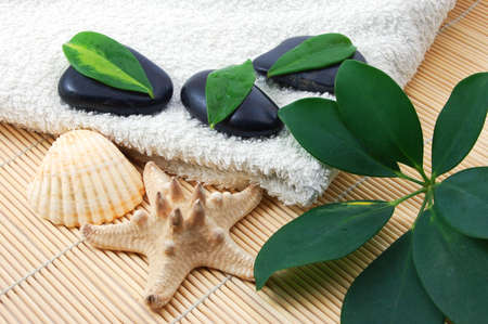 towel and zen stones showing a bath or wellness concept Stock Photo - 4490204