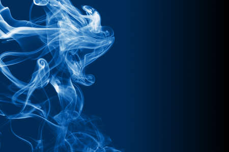 creativ: abstract smoke background with colorful smoke on black