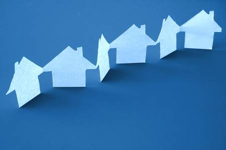 neighbour: paper houses or homes showing a concept for real estate  Stock Photo