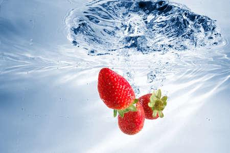 strawberry splash in warter showing healthy lifestyle Stock Photo - 4534563