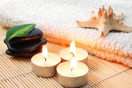 towel and zen stones showing a bath or wellness concept Фото со стока