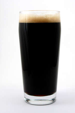dark beer isolated on white background with foam photo