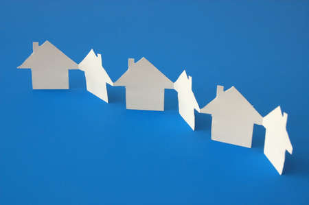 housing crisis: house of paper showing a concept for home and neighborhood Stock Photo