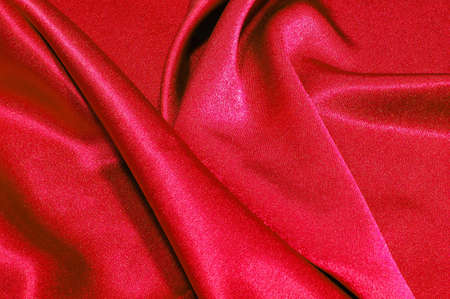 valuables: red satin or silk background with textile texture