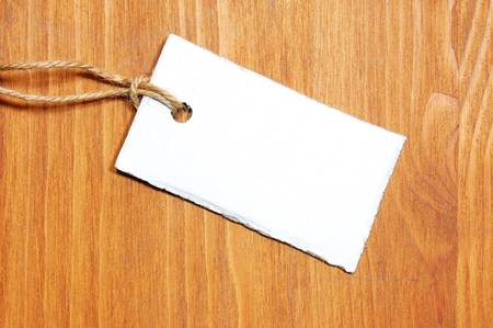 blank price tag with copyspace on a wood texture Stock Photo - 4606966