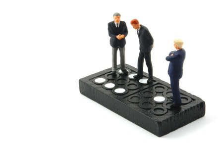 business man on domino isolated on white background Stock Photo - 4606971