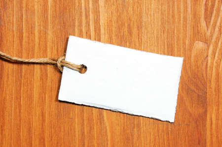 blank price tag with copyspace on a wood texture Stock Photo - 4628185