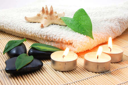 sauna: towel and zen stones showing a bath or wellness concept Stock Photo