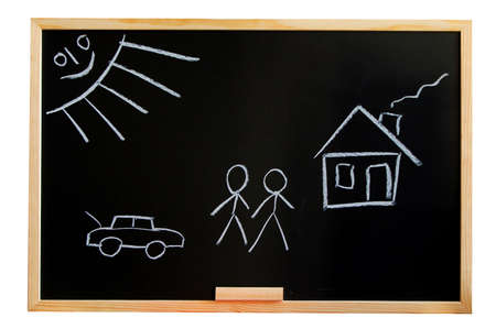 blackboard with a drowing of a house and a familie Stock Photo - 4692405