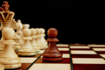 challange: chess pieces showing concept of conflict power and success
