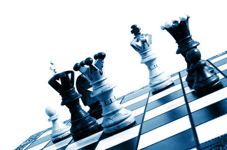 chess pieces on a chess board showing concept for strategic business Stock Photo