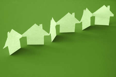 paper houses or homes showing a concept for real estate  photo