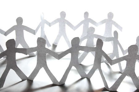 community help: paper people doing teamwork in their business Stock Photo