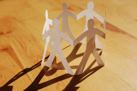 paper man showing concept for business teamwork and love photo
