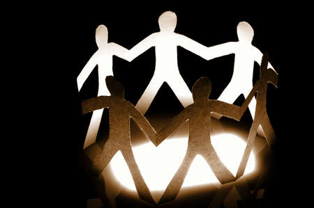 paper man showing teamwork help love and social networking photo