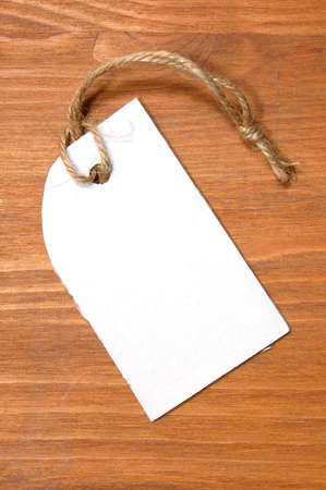 blank price tag with copyspace on a wood texture Stock Photo - 4755886