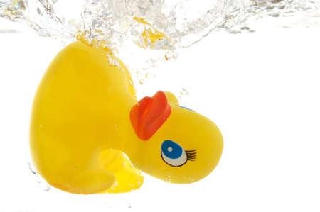 rubber duck in bath bathroom splashing in water photo