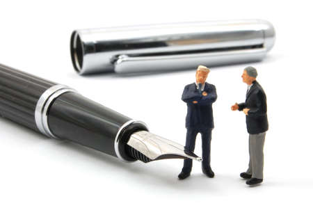 business man and pen isolated on white background photo
