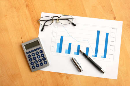 business still life with coffee and chart showing success Stock Photo - 4861934