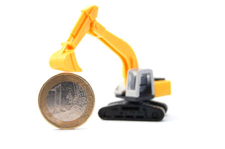 industrie: making euro money coins with digger isolated on white background