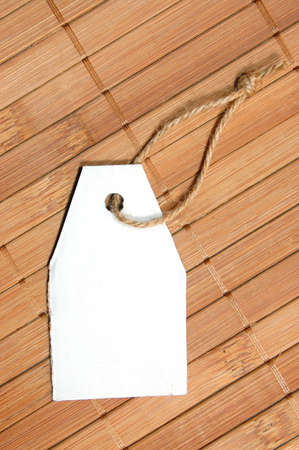 blank price tag with copyspace on a wood texture photo
