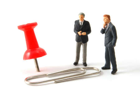 business man and push pin in a office isolated on white background photo