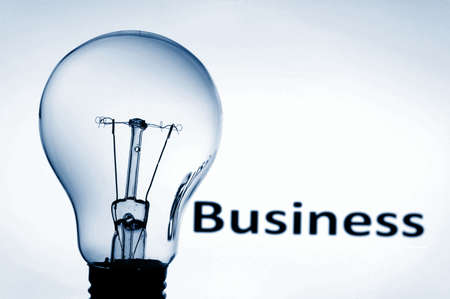 bulb on blue background showing business concept with copyspace photo
