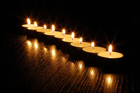romantic candle light on a black background Stock Photo - 4927497
