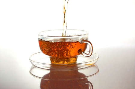 auroral: cup of tea on white with reflection Stock Photo