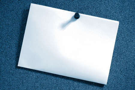 blank and empty sheet paper with copyspace on bulletin board in office photo