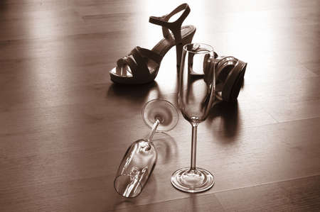 allurement: sexy high heels and champange  or sparkling wine glass