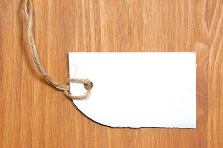 blank price tag with copyspace on a wood texture Stock Photo - 4937892