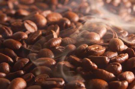 roasting: roasting coffee beans with steam and smoke Stock Photo