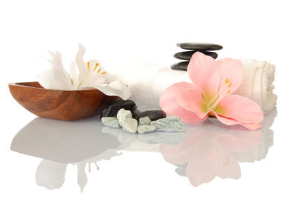 wellness zen and spa still life with flower towel and pebbles isolated on white Stock Photo - 4960590