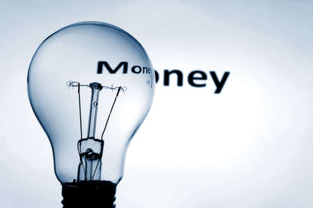 bulb and money text showing concept of financial success photo