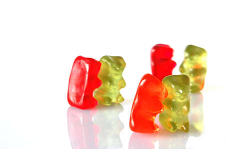 sweet gummy bears dancing on a party on white background Stock Photo - 4968259
