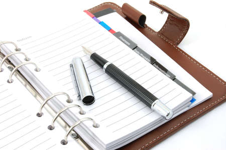 empty business notebook or organizer with pen photo