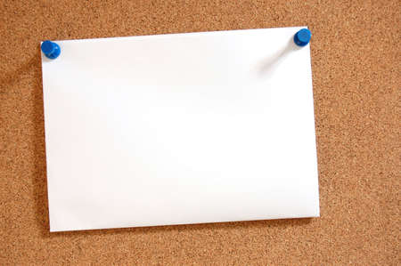 bulletinboard: blank and empty sheet paper with copyspace on bulletin board in office