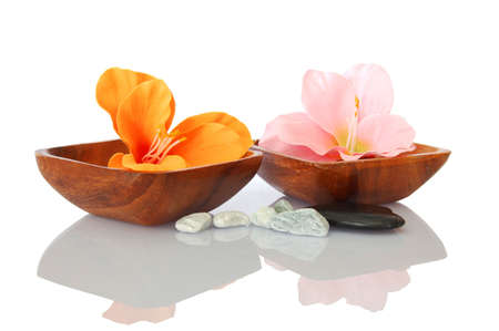 alternative wellness: spa and bath still life with flowers and pebbles showing asian alternative medicine
