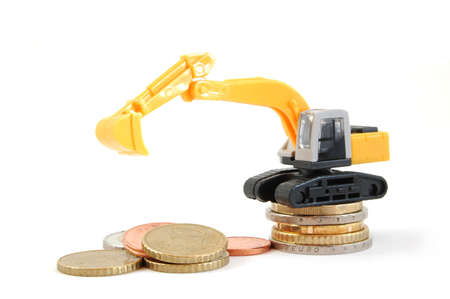 making euro money coins with digger isolated on white background Stock Photo - 5036443