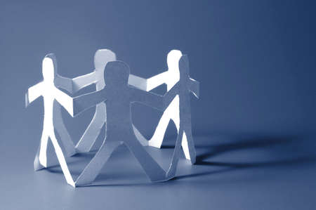 concept for friendship friends team teamwork love and help with paper man photo
