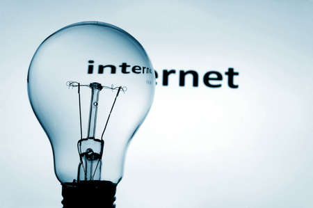 bulb on blue background showing concept of internet communication photo