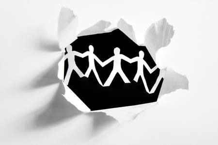 chain of paper man in a hole showing teamwork                    photo