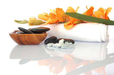 wellness zen and spa still life with flower towel and pebbles isolated on white Stock Photo - 5051687